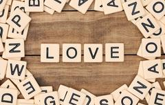 Love spelled out in tan tile letters - stock photo