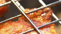One slice of grilled juicy pork steaks over coals, on the brazier, macro Stock Footage