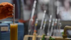 Winemaker Making Wine Test in Winery Cellar - stock footage