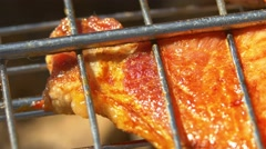 Delicious slice of juicy pork steaks over coals, grilled, on the brazier, macro Stock Footage