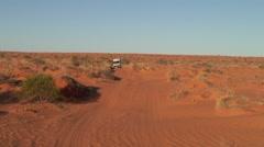 Jeep drive through sandy Simpson Desert 1 - stock footage