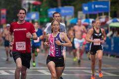 Tired Runners Push For Finish Line At Peachtree Road Race Stock Photos
