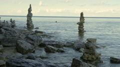 Stone balance at the bank of river Stock Footage
