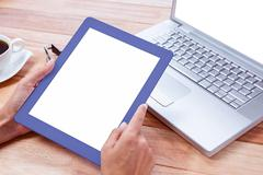 Stock Photo of Feminine hands holding tablet