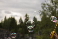 Blowing Soap Bubbles - stock photo