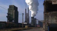 The smoke from the chimney of an overall plan view of the plant - stock footage