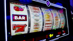 Close up woman playing slot machine Stock Footage