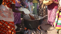 Africa native village women cooking rice with mankara Stock Footage