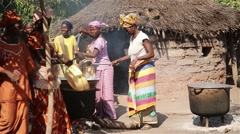 Africa native village women cooking Stock Footage