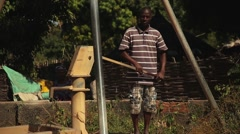 Stock Video Footage of Africa native village well man no water