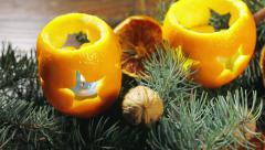 Dried oranges with nuts and burning candles Stock Footage