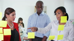 4K Creative business group in office brainstorming for ideas with sticky notes - stock footage