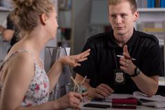 Police officer interrogating woman - stock photo