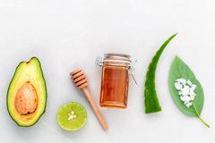 Alternative skin care  and scrub fresh  avocado , leaves ,sea salt , oils, li Stock Photos