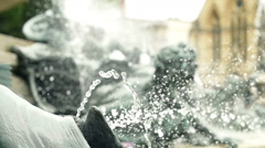 Slowmotion of fountain in front of Victoria Rooms in Bristol Stock Footage