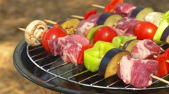 Assorted meat from chicken, pork and various vegetables for barbecue on grill Stock Footage