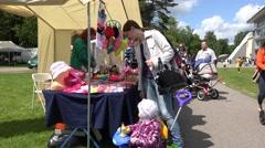 Parents buy various decorative souvenirs for children. 4K Stock Footage