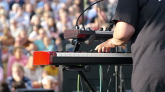 Hands of musician playing keyboard in concert Stock Footage
