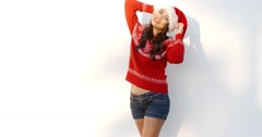 Beautiful Girl in Santa Hat and Red Woolen Sweater Stock Footage
