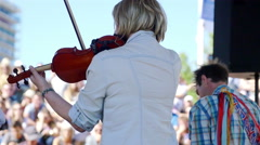 young female violinist playing on the stage of a concert - stock footage