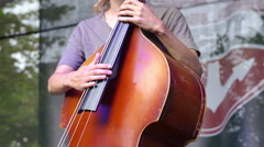 Musician playing contrabass in a concert - stock footage