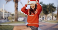 Young Smiling Beautiful Girl in Santa Hat Stock Footage