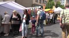 Colorful sweets candies sold in street fair and people with kids. 4K Stock Footage