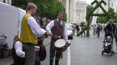 Stock Video Footage of citizen and tourist people enjoy folklore group playing music. 4K