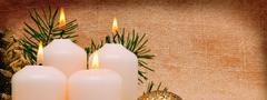 Four white Advent candles . Stock Photos