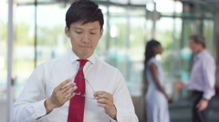 Stock Video Footage of 4K Portrait of smiling businessman standing in modern office building