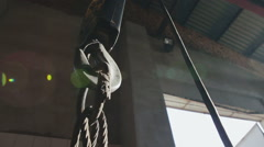 Metallic industrial hook for lifting heavy things in the factory in the movement Stock Footage