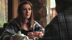 Girls talk and drink their tea porcelain teapot on the veranda - stock footage