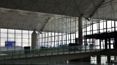 Hong Kong Airport roof, windows, aircraft landing & person Stock Footage
