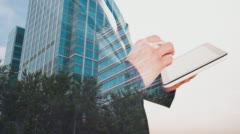 Double exposure of modern London office building and businessman using tablet 4k - stock footage