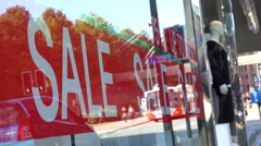 Red Sale Sign in Crowded Shopping Mall Stock Footage