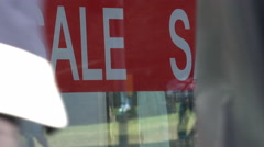 Sale sign, notice banner in shop window for summer reduction price by day - stock footage