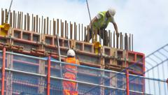 Men at work in the construction site Stock Footage