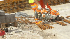 Power saw in use in a construction site  Stock Footage