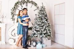 Christmas Couple.Happy Smiling Family at home celebrating.New Year People - stock photo