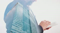 Businessman typing on tablet double exposure with London office building 4k Stock Footage