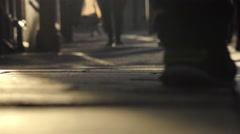 People walking on the sidewalk: sunset silhouette Stock Footage