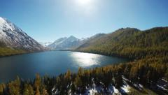 4K UHD Aerial Rising Above Mountain Lake at Sunny Day Stock Footage