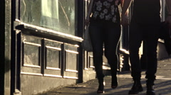 People walking down the street at sunset Stock Footage