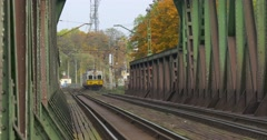 Passenger Train is Moving Away by Railroad Railway Rails Metal Railroad Bridge Stock Footage