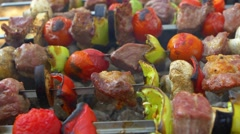 Stock Video Footage of Assorted meat from chicken, pork and various vegetables for barbecue on grill