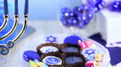 Table set with cocktails and chocolates to celebrate Hanukkah. Stock Footage