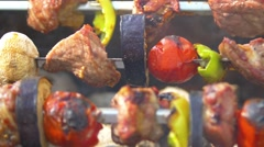 Stock Video Footage of Tomato, meat, eggplant and mushroom is baked on skewers kebabs, barbeque