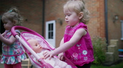 4K Cute toddler twins playing in the garden at home Stock Footage