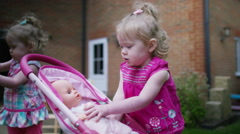 4K Cute toddler twins playing in the garden at home - stock footage