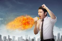 Business man holding megaphone in fire and shouting Kuvituskuvat